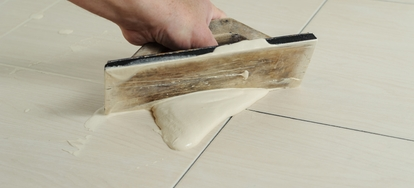 The correct consistency of tile grout being installed